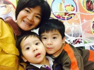 Tran Ti Nga who was helped by Amnesty International with her young sons